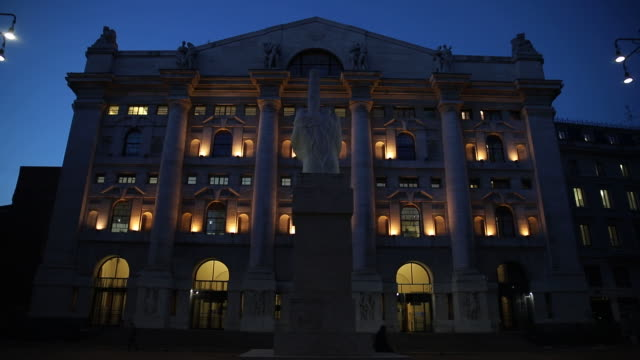facade of the borsa italiana, italy's stock exchange, with a marble sculpture by maurizio cattela illuminated at night. the italy's stock exchange is... - italian culture stock videos & royalty-free footage