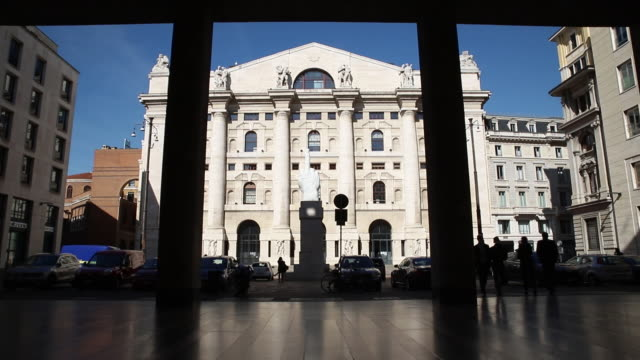 facade of the borsa italiana, italy's stock exchange, with a marble sculpture by maurizio cattelan. the italy's stock exchange is part of the london... - italian culture stock videos & royalty-free footage