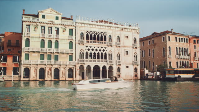 ws - facade of the ca' d'oro from the grand canal, boats passing by - palace stock videos & royalty-free footage