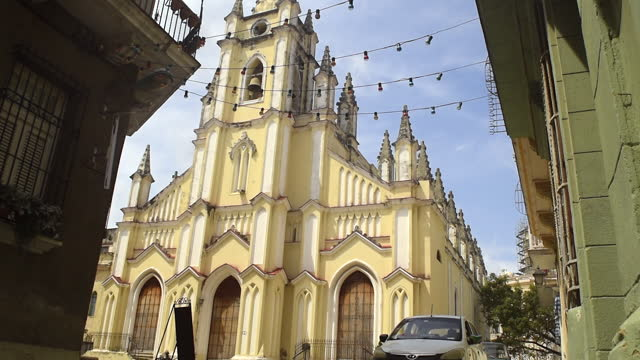 facade of the 'iglesia del angel custodio' on april 10 in old havana, cuba. the image is an establishing shot in the cuban capital city. - temple building stock videos & royalty-free footage