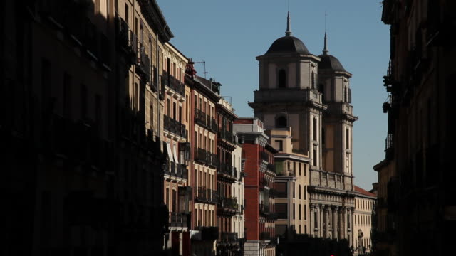 ms facades of old buildings and st. isidore church / madrid, spain - campo totale video stock e b–roll