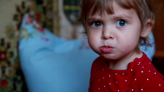 face close-up of a baby chewing with full mouth - chewing stock videos & royalty-free footage