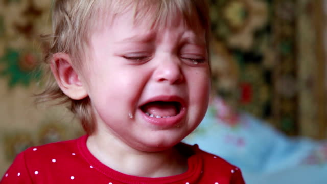 face close-up of a crying baby - girls stock videos & royalty-free footage