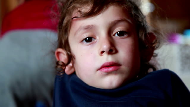 face close-up of a smiling child looking at camera - bending stock videos & royalty-free footage