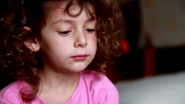 face close-up of a surprised little girl - sulking stock videos & royalty-free footage