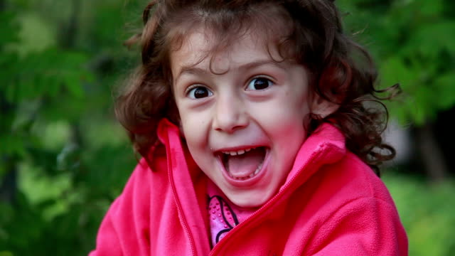 face close-up of an excited little girl - excitement stock videos & royalty-free footage