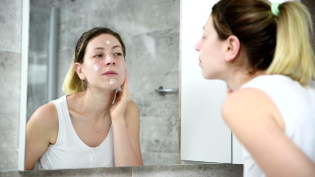 face cream rubbing - 4k resolution - cream coloured stock videos & royalty-free footage