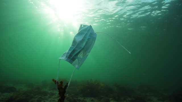 face mask pollution in the ocean - undersea stock videos & royalty-free footage