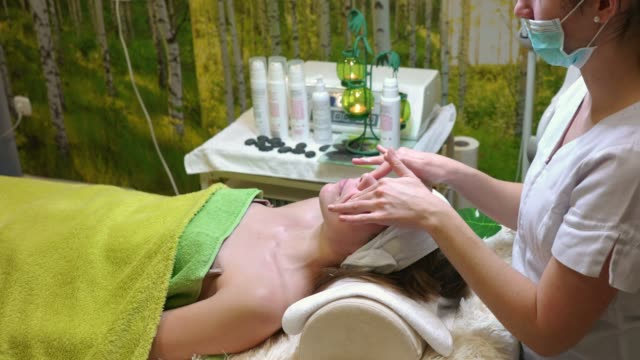 face massage at beauty salon - facial massage stock videos and b-roll footage