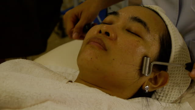 face massage - facial massage stock videos and b-roll footage