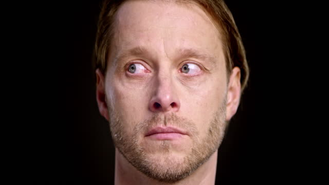 face of a caucasian man moving his eyes around - staring stock videos & royalty-free footage