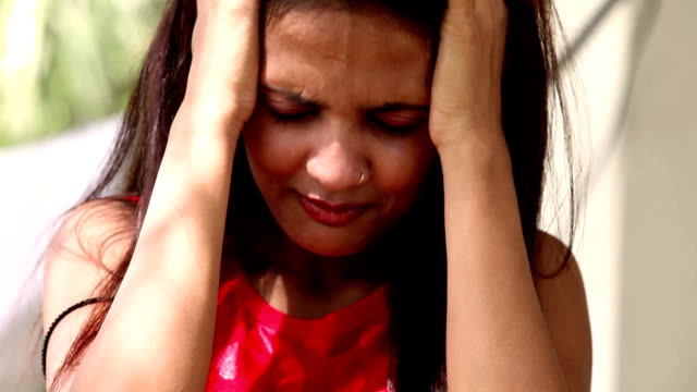 face of a crying young of indian ethnicity - solitude stock videos & royalty-free footage