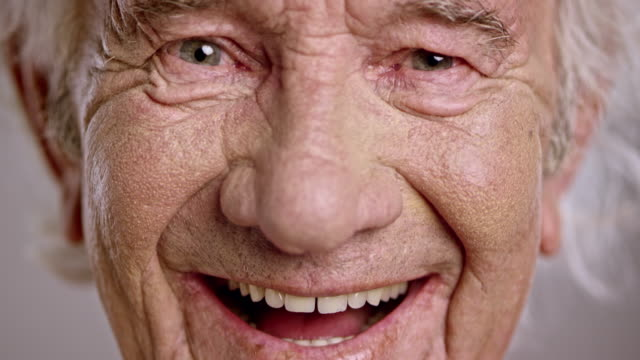 face of a laughing senior caucasian man - eye stock videos & royalty-free footage