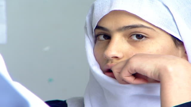 face of a pretty druze schoolgirl wearing a traditional headscarf or mandil, in an english class at irfan, a druze religious school in the chouf... - theology stock videos & royalty-free footage