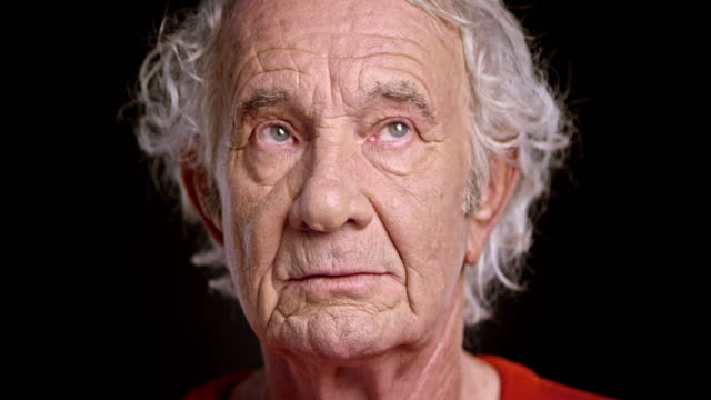 Face of a senior Caucasian man looking around