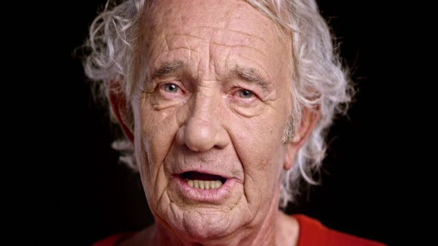 face of a senior caucasian man talking - senior men stock videos & royalty-free footage