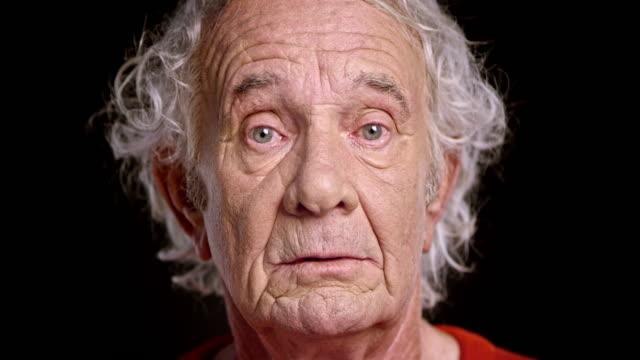 face of a senior caucasian man - senior men stock videos & royalty-free footage