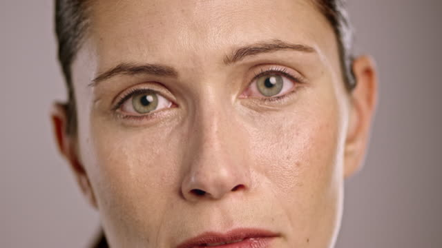 face of a young caucasian woman crying - worried stock videos & royalty-free footage