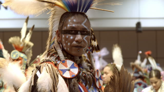 cu face of american indian man at traditional powwow competition looking straight into camera / indio, california, usa - indigenous north american culture stock videos and b-roll footage