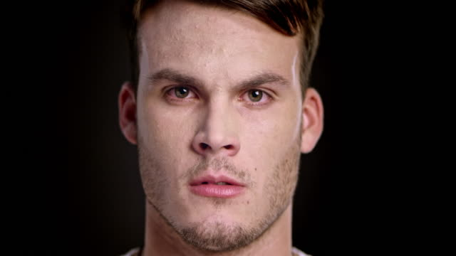 Face of an angry young Caucasian man talking