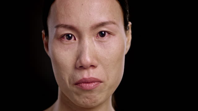 face of an asian woman crying - teardrop stock videos and b-roll footage