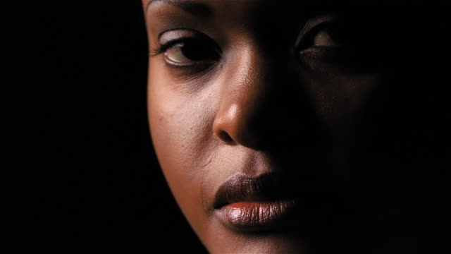 face of bleary-eyed african american woman - profile stock-videos und b-roll-filmmaterial
