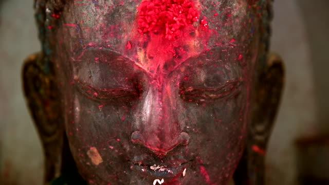 a face of buddha with the red dot (tika powder) in kathmandu, nepal - kathmandu stock videos & royalty-free footage