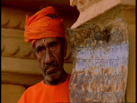 cu face of hindu priest in temple, bandhavgarh national park, india - national icon stock videos & royalty-free footage