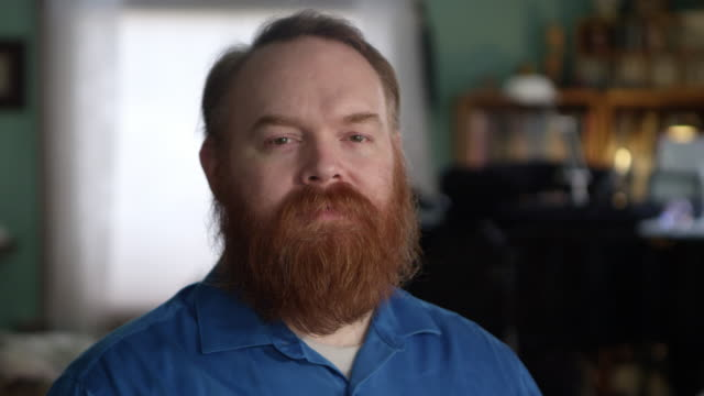 Face of man with red hair and beard with sad eyes