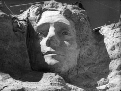 b/w 1936 face of thomas jefferson at unfinished mt rushmore / newsreel - thomas jefferson stock videos & royalty-free footage