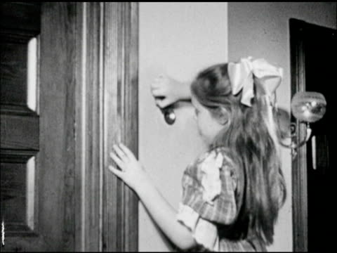 21 td ms woman talking into 'new speaking tube' on wall girl in room responding to listening hole in wall - intercom stock videos and b-roll footage
