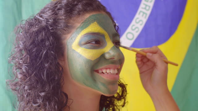 face painting flag of brazil - human face drawing stock videos & royalty-free footage