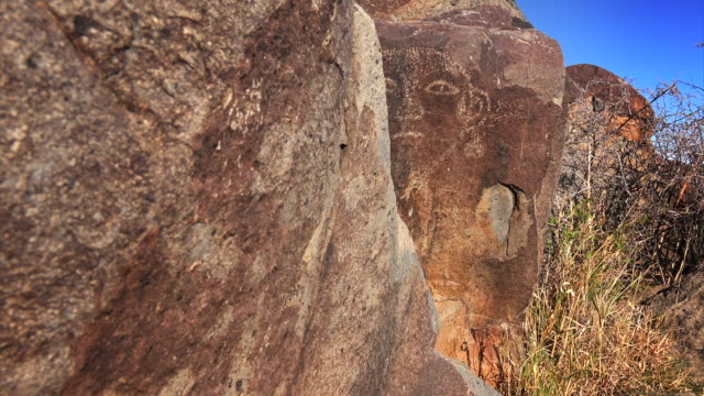 face petroglyph at three rivers petroglyph site in new mexico, usa. - cave painting stock videos & royalty-free footage