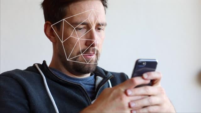 vídeos de stock e filmes b-roll de face recognition scanning with smartphone - documentos