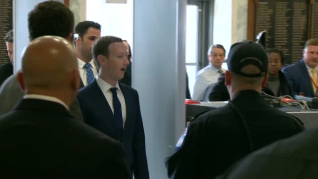 facebook founder and ceo mark zuckerberg enters a house office building and walks through a magnetometer to a police escort on arriving for a hearing... - privacy stock videos & royalty-free footage