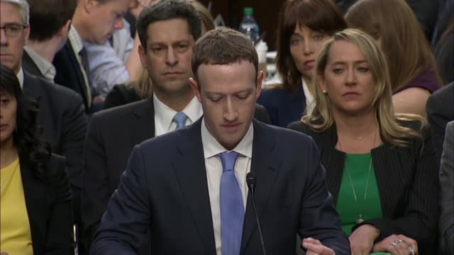 Facebook founder and CEO Mark Zuckerberg reads from prepared remarks before Senate committees at a joint hearing on data privacy Zuckerberg says...