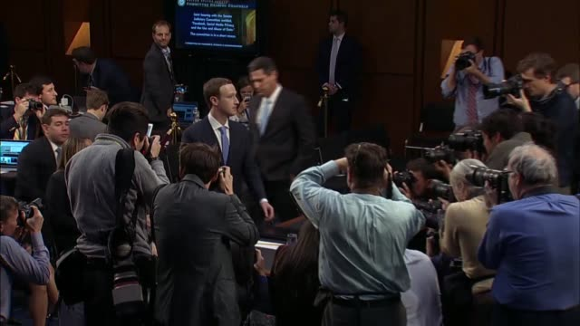 facebook founder and ceo mark zuckerberg reenters a senate hearing room to continue testimony before the senate judiciary and commerce committees - testimony stock videos & royalty-free footage