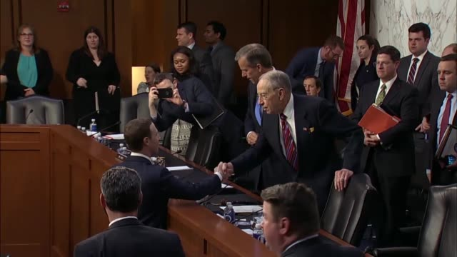 facebook founder and ceo mark zuckerberg walks to the dais to shake hands with senate judiciary committee chairman chuck grassley and commerce... - testimony stock videos & royalty-free footage
