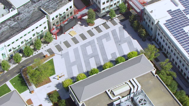 WS AERIAL POV Facebook headquarters campus area with HACK lettering / Menlo Park, California, United States