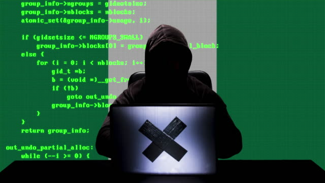 faceless nigerian hacker typing code hacking on his laptop with nigeria flag in background - nigerian flag stock videos & royalty-free footage