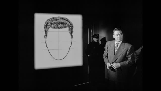 1948 a facial composite of a criminal is created with aid of many witnesses - human face drawing stock videos & royalty-free footage