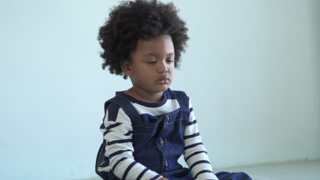 facial expreesion by african-american ethnicity little boy , cry , sadness - shy stock videos & royalty-free footage