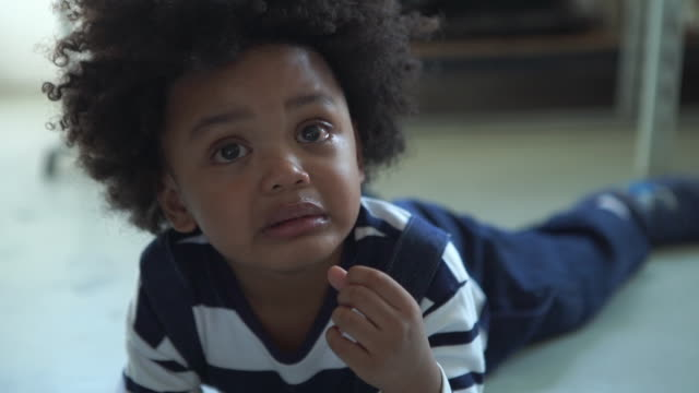 facial expreesion by african-american ethnicity little boy , cry , sadness - childhood stock videos & royalty-free footage