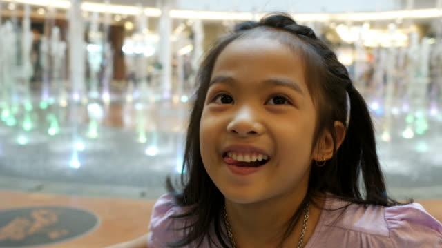 vídeos de stock e filmes b-roll de facial expression by asian girl , embarrassment face - só uma rapariga