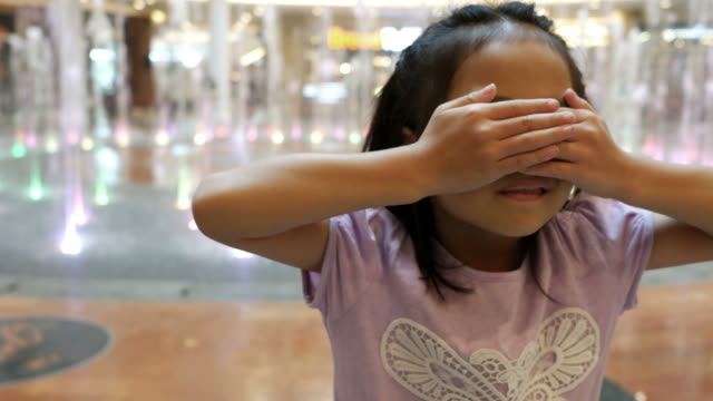 facial expression by asian girl , peekaboo game - peekaboo game stock videos & royalty-free footage