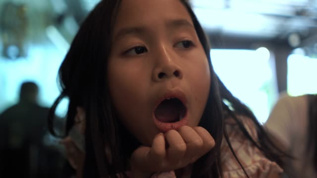 facial expression by asian girl , yawning - meal stock videos & royalty-free footage