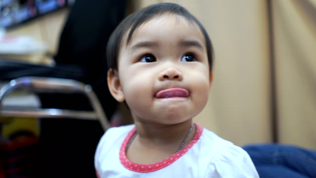 facial expression by asian little girl , sticking out tongue - sticking out tongue stock videos & royalty-free footage