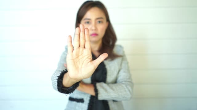facial expression by Asian mature woman ,bad condition , reject , Stop Gesture,