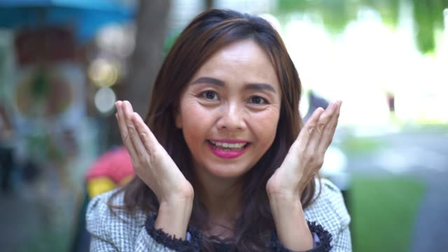 facial expression by asian mature woman , peekaboo game - peekaboo game stock videos & royalty-free footage