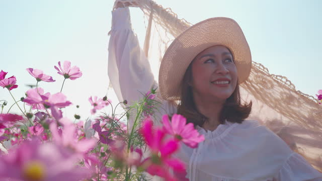 facial expression by asian mature woman resting in cosmos meadow , feel freedom , hands rised with shawl - shawl stock videos & royalty-free footage